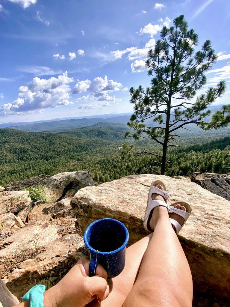 Sitting outside by the Mogollon Rim, sipping on a camping mug